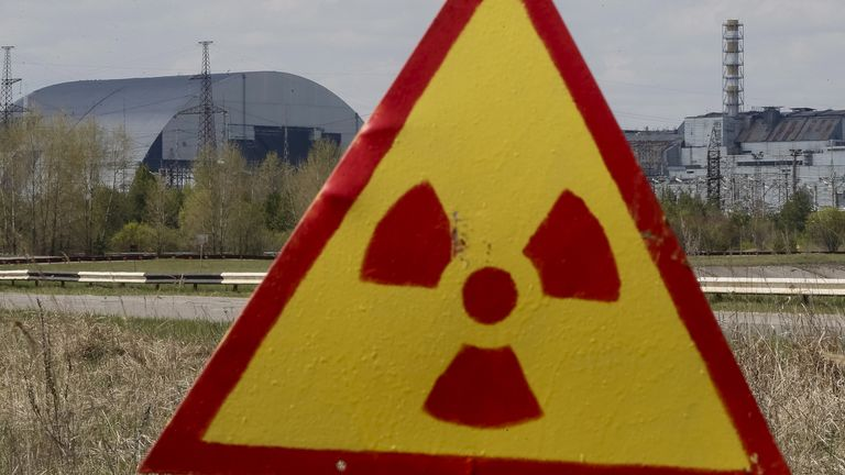 A general view shows the New Safe Confinement (NSC) structure (left) at the site of the Chernobyl nuclear power plant, northern Ukraine