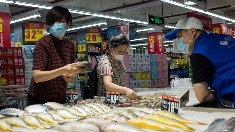 People look at fresh seafood in a supermarket following an outbreak of the coronavirus disease (COVID-19) in Beijing, China, August 13, 2020