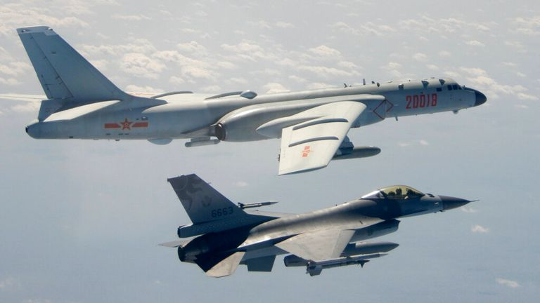 A Taiwanese Air Force F-16 in foreground flies on the flank of a Chinese People's Liberation Army Air Force (PLAAF) H-6 bomber as it passes near Taiwan. Pic: AP