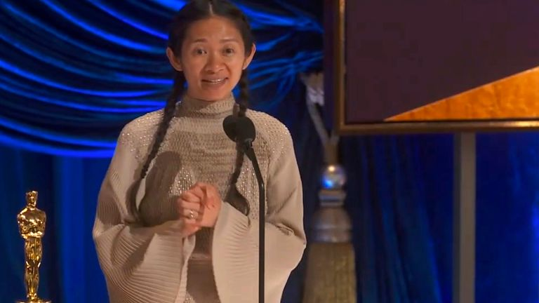 "In this video image provided by ABC, Chloe Zhao accepts the award for best director for ""Nomadland"" at the Oscars on Sunday, April 25, 2021. (ABC via AP)"