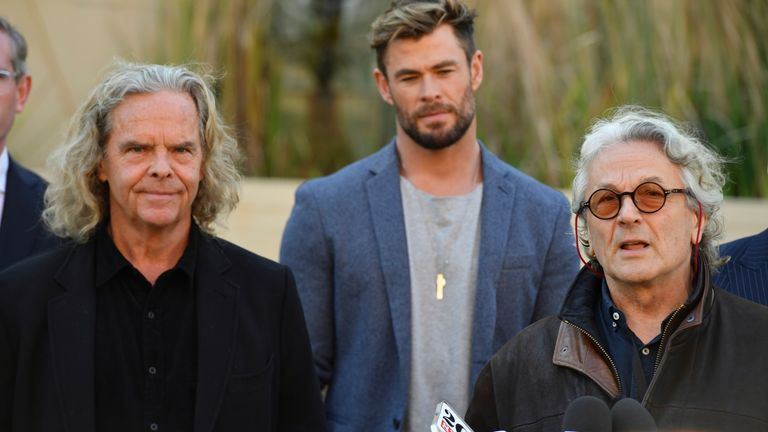 Producer Doug Mitchell, actor Chris Hemsworth and director George Miller at a press conference to announce the new Mad Max film at Fox Studios Australia in Sydney, Monday, April 19, 2021.  (AAP Image/Mick Tsikas) NO ARCHIVING