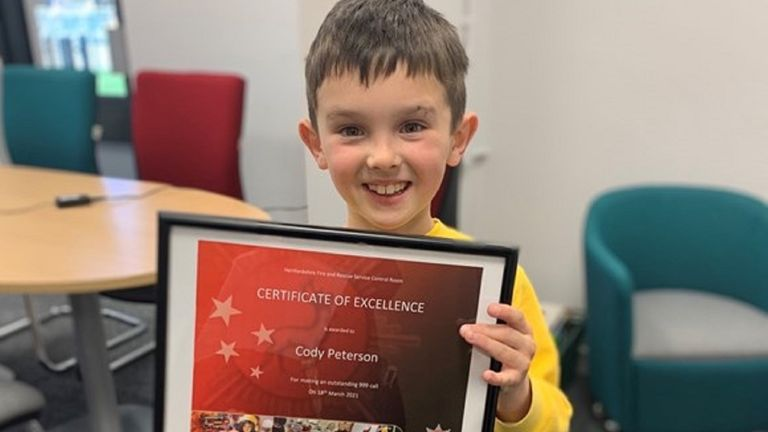 Cody Peterson, an eight-year-old, has been praised for his calmness after he successfully called 999 and guided fire crews to a neighbour's house that had caught fire in Watford, Hertfordshire.