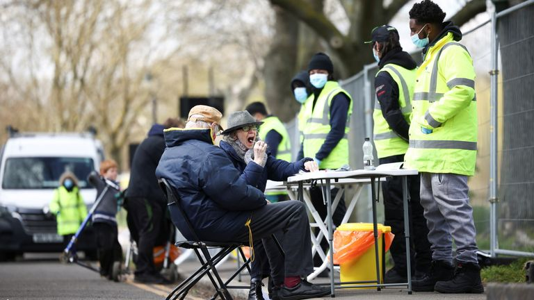 People swab themselves for coronavirus disease (COVID-19) at a testing site on Clapham Common in London