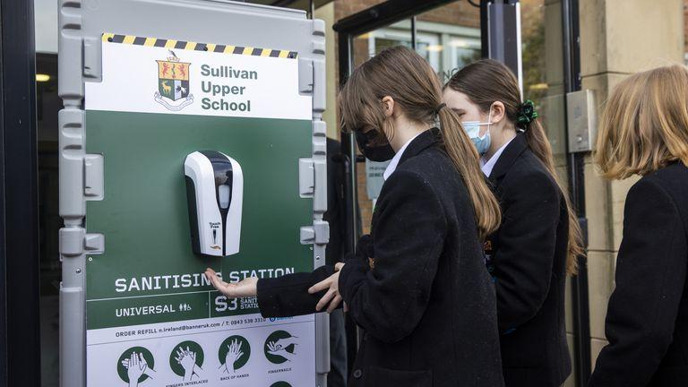 Pupils use a hand sanitisation station at Sullivan Upper School in Holywood