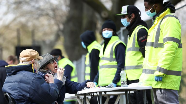 People swab themselves for coronavirus at a testing site on Clapham Common, London