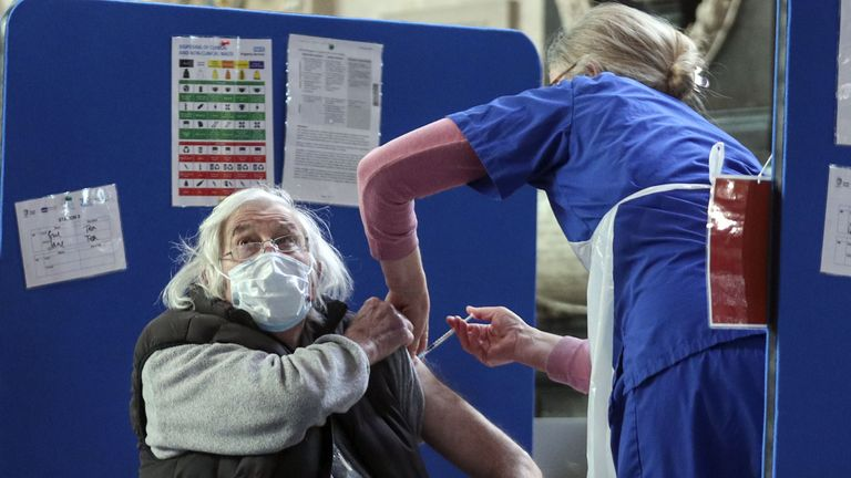 Embargoed to 0001 Monday March 29 A man receives an injection of the coronavirus vaccine at Salisbury Cathedral, Wiltshire. Vacinations are continuing to be carried out in the cathedral and some patients are now reaching their second dose. Picture date: Saturday March 27, 2021.
