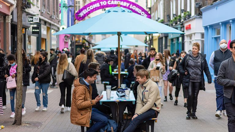 People enjoying food and drinks in Carnaby Street area. People in England flock back to Pubs and Restaurants as lockdown restrictions were eased on Monday 12th April. (Photo by Pietro Recchia / SOPA Images/Sipa USA)