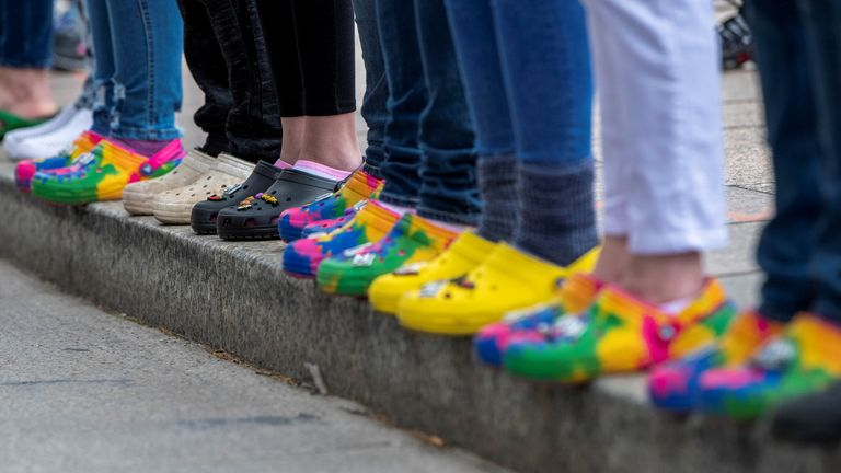 """People wore the customisable shoe during a protest against the police after 16-year-old Ma'Khia Bryant was shot in Ohio on 24 April. It was part of the """"Show Your Crocs for Ma'Khia Bryant"""" demonstration"""