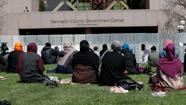The Minnesota branch of the Council on American-Islamic Relations holds Friday prayers outside a government building in Minneapolis