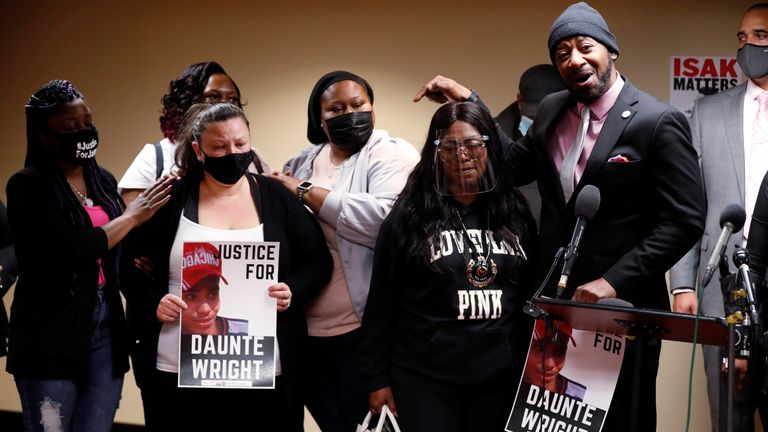 Katie Wright (left) mother of Daunte Wright is pictured at a protest in Minneapolis on Friday