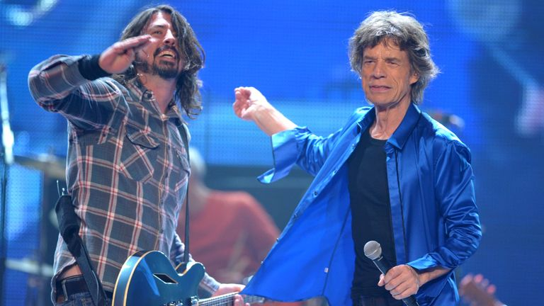 "Dave Grohl, left, performs with Mick Jagger of the Rolling Stones on the ""50 & Counting"" tour at the Honda Center on Saturday, May 18, 2013 in Anaheim, Calif. (Photo by John Shearer/Invision/AP)"