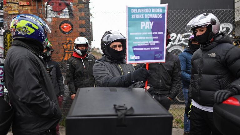 Deliveroo riders from the Independent Workers' Union of Great Britain (IWGB) in Shoreditch High Street, east London, as they go on strike in a dispute for fair pay, safety protections and basic workers' rights. Picture date: Wednesday April 7, 2021.