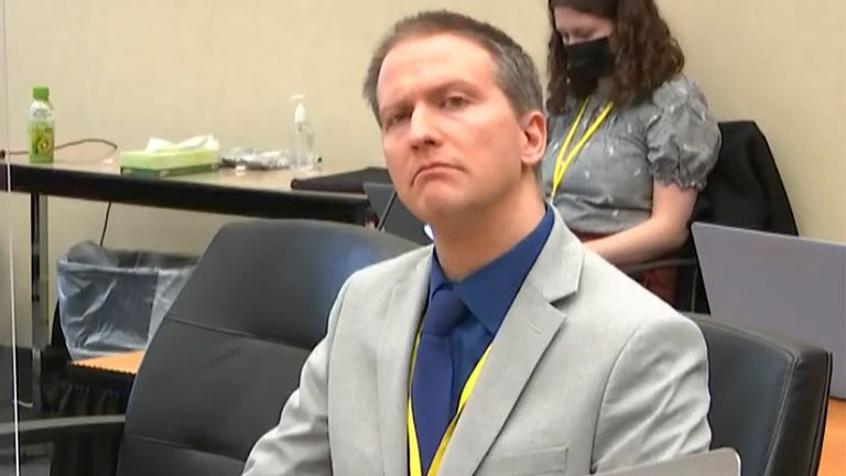 Minneapolis police Officer Derek Chauvin listens, without his face mask, as his defence attorney Eric Nelson gives closing arguments