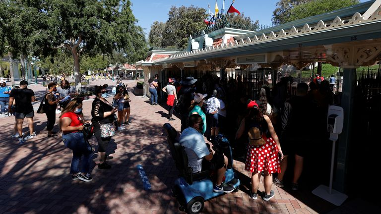 People walk outside Disneyland Park on its reopening day amidst the coronavirus disease (COVID-19) outbreak, in Anaheim, California, U.S.