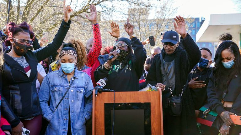 DMX'S ex-wife, Tashera Simmons, left, and his fiance Desiree Lindstrom, second from left, are joined by family and friends as they pray during a vigil outside White Plains Hospital in New York. Pic: AP