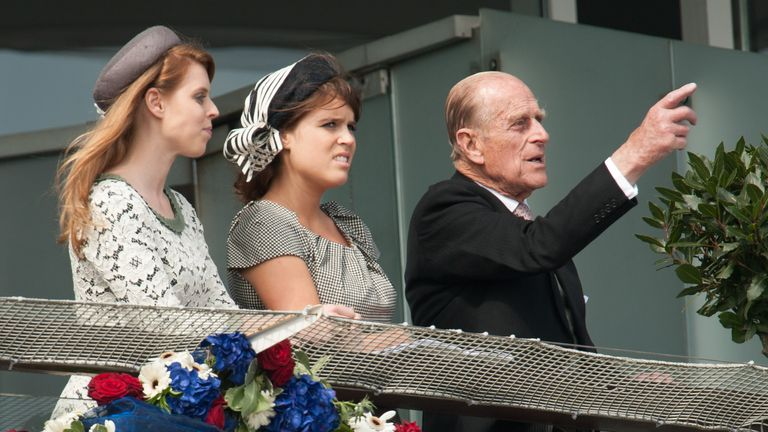 The Duke of Edinburgh with Princess Beatrice (L) and Princess Eugenie at Epsom race course in 2012