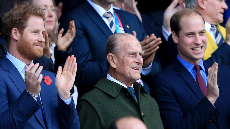 The Duke of Edinburgh with Prince William and Prince Harry at the Rugby World Cup final at Twickenham in 2015