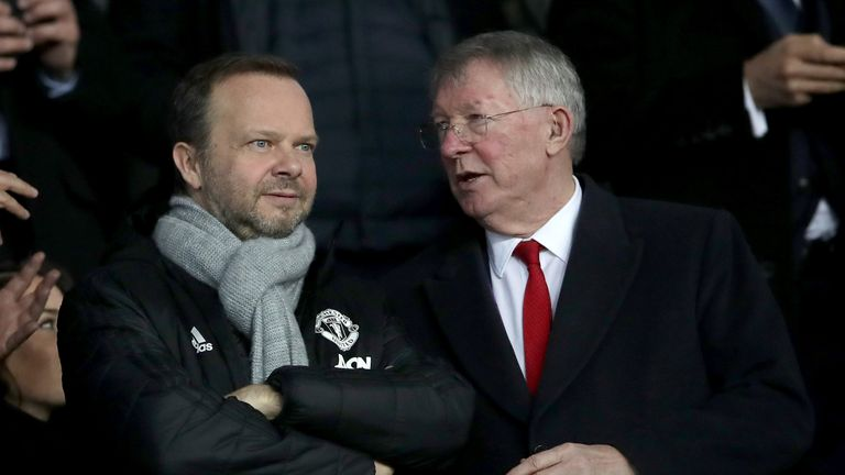 Mr Woodward (left) is pictured in the stands with Sir Alex Ferguson in 2019