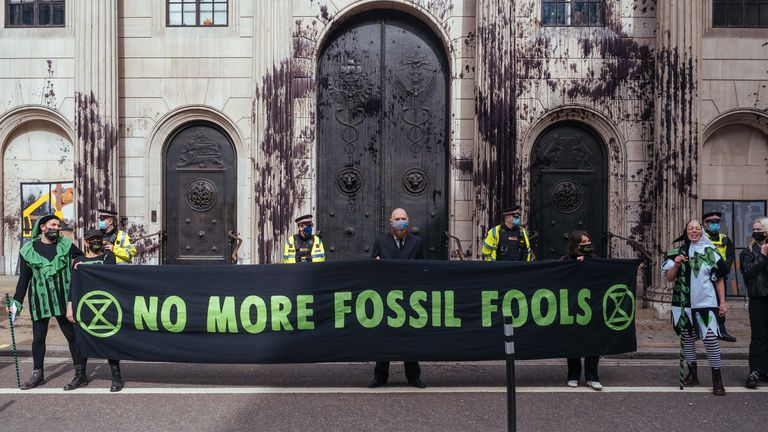 Handout photo issued by Extinction Rebellion of their protest outside the Bank of England in London against the role of banks in the climate crisis. Demonstrators covered the outside of the bank in a substance made of a mixture of black pond dye and guar gum - a thickening agent. Picture date: Thursday April 1, 2021.