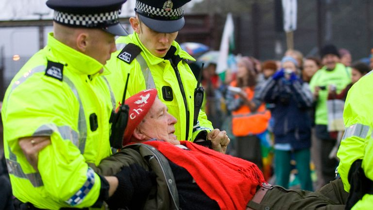A protester is arrested by police during a blockade of the Naval Base, Faslane, Scotland October 1, 2007. The blockade comes on the last day of the non-violent protest organised by Faslane 365 against nuclear submarines at the base which houses the Uk's Trident missiles. REUTERS/Chris Clark (BRITAIN)