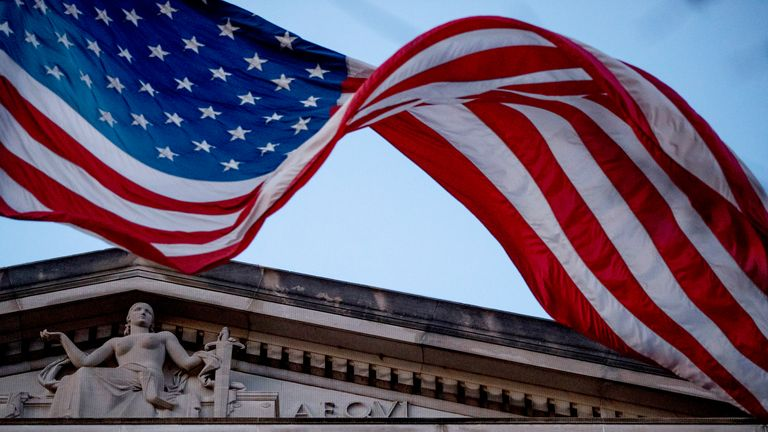 An American flag flies outside the Department of Justice in Washington, Friday, March 22, 2019. Special counsel Robert Mueller has concluded his investigation into Russian election interference and possible coordination with associates of President Donald Trump. The Justice Department says Mueller delivered his final report to Attorney Barr, who is reviewing it. (AP Photo/Andrew Harnik)