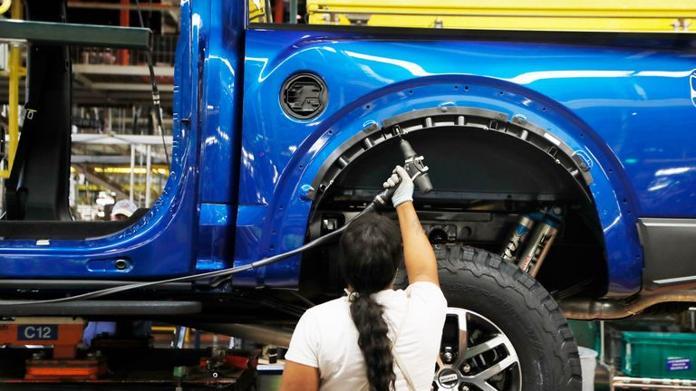 In this Sept. 27, 2018, file photo a United Auto Workers assemblyman works on a 2018 Ford F-150 truck being assembled at the Ford Rouge assembly plant in Dearborn, Mich. Pic: AP
