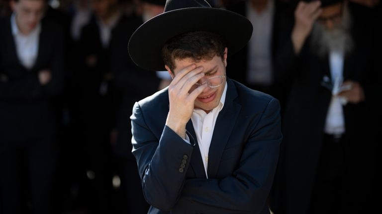 Ultra-Orthodox Jews mourn during the funeral of Moshe Ben Shalom. Pic: AP