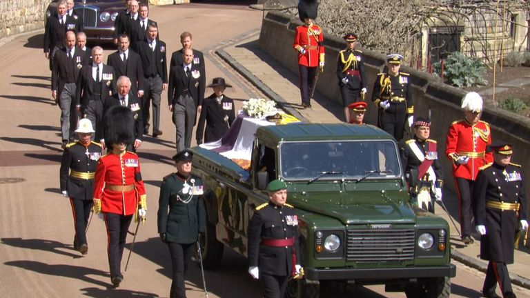 The royal family walk behind the coffin