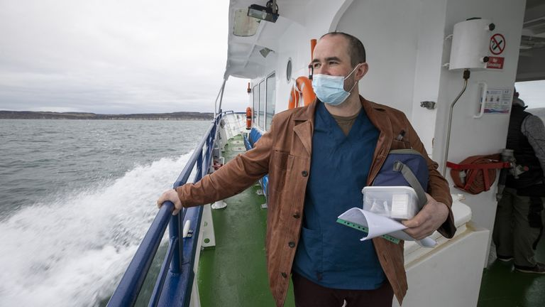 Health worker Gavin Chestnutt travelling to Rathlin Island, Northern Ireland, to provide vaccinations