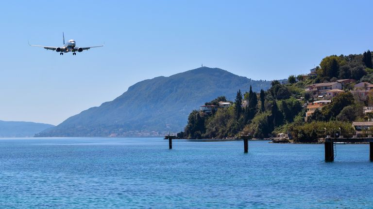 CORFU, GREECE - APRIL 8, 2018: Modern passenger airplane of Ryanair airlines before landing at Corfu island airport, Greece. (CORFU, GREECE - APRIL 8, 2018: Modern passenger airplane of Ryanair airlines before landing at Corfu island airport, Greece.,