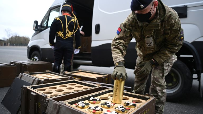 A member of The King's Troop Royal Horse Artillery places empty shells into boxes ahead of a gun salute