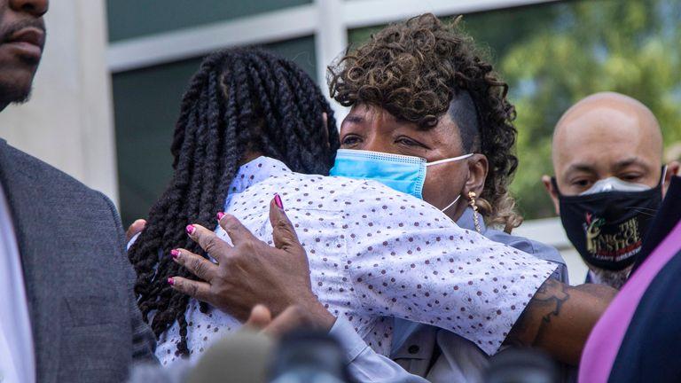 Eric Garner's mother, Gwen Carr hugs Andrew Brown Jr's son Khalil Ferebee. Pic: AP
