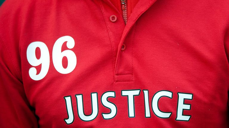 A fan wears a shirt in memory of the Hillsborough disaster
