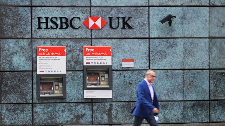 A worker walks past a branch of HSBC bank in the City of London financial district in London September 4, 2017. REUTERS/Toby Melville