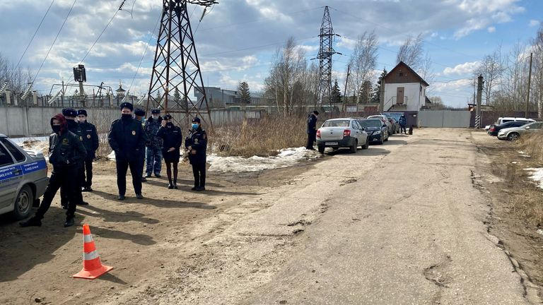 Police officers gather near the IK-2 corrective penal colony in Pokrov