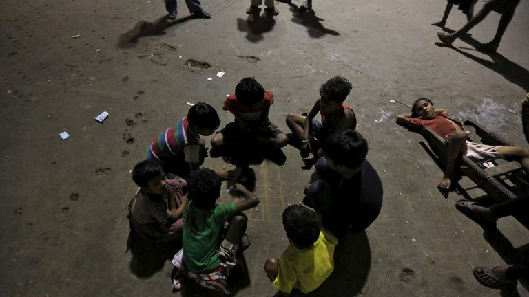 Homeless children play in a parking area of a railway station in Kolkata, India, March 14, 2016