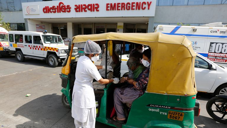 A COVID-19 patient attended by a health worker in Ahmedabad, India. Pic: AP