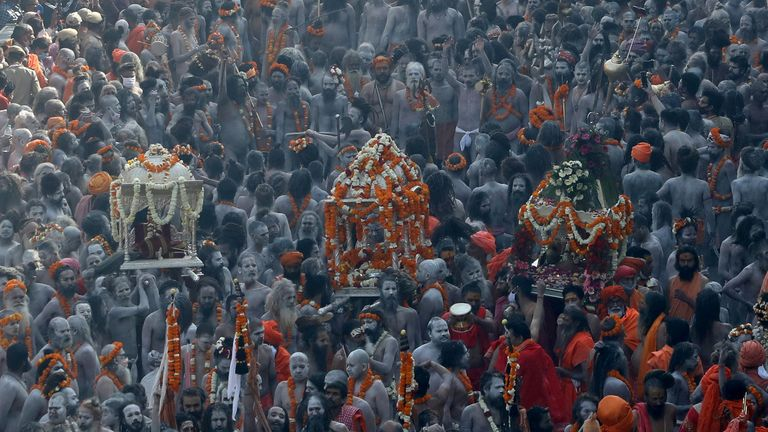 "Naga Sadhus, or Hindu holy men participate in a procession to take a dip in the Ganges river during Shahi Snan at ""Kumbh Mela"", or the Pitcher Festival, amidst the spread of the coronavirus disease (COVID-19), in Haridwar, India, April 14, 2021. REUTERS/Anushree Fadnavis TPX IMAGES OF THE DAY"