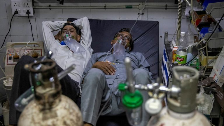 Due to a shortage of beds in hospitals, patients are forced to share beds as they received treatment for the virus