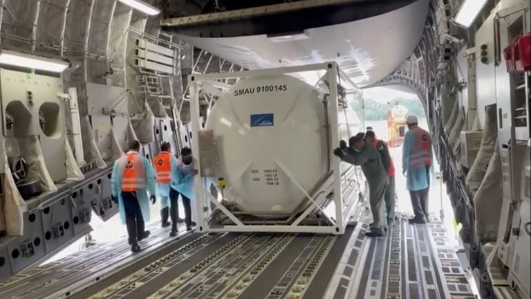 An oxygen tank is loaded into an aircraft to supply hospitals in India running out of supplies amid coronavirus disease (COVID-19) outbreak, at the tarmac of Changi Airport in Singapore April 24, 2021 in this still image taken from video recorded on April 24, 2021. High Commission of India for Singapore/via REUTERS THIS IMAGE HAS BEEN SUPPLIED BY A THIRD PARTY. MANDATORY CREDIT. NO RESALES. NO ARCHIVES.