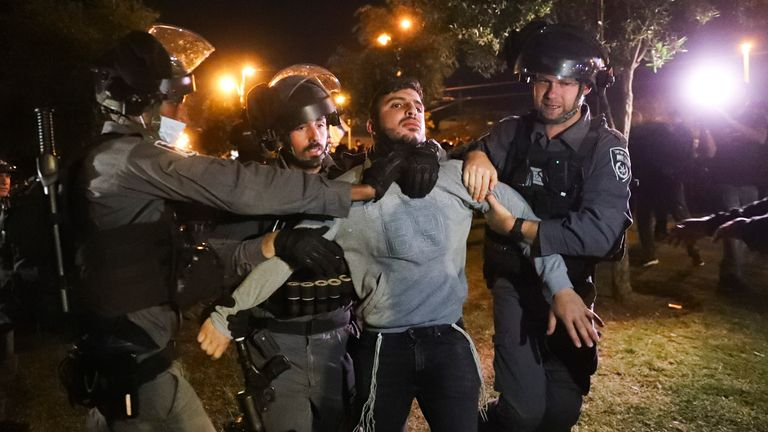 Israeli border police detain an Israeli youth as members of ...Lahava..., a Jewish extremist group try approach to Damascus Gate to protest amid heightened tensions in the city, just outside Jerusalem's Old City, Thursday, April. 22, 2021. (AP Photo/Ariel Schalit)
