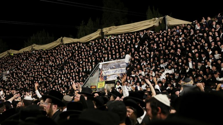 Tens of thousands are seen singing and dancing earlier at the Lag B'Omer event