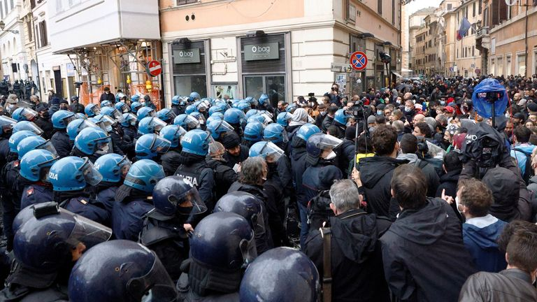 Police officers block a street during a protest of restaurant and small business owners who call for their businesses to be allowed to re-open, despite no authorization for the demonstration by the government, amid the coronavirus disease (COVID-19) outbreak, in Rome, Italy, April 12, 2021. REUTERS/Guglielmo Mangiapane