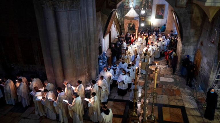 Priests participate Easter Sunday mass at the Church of the Holy Sepulchre in Jerusalem