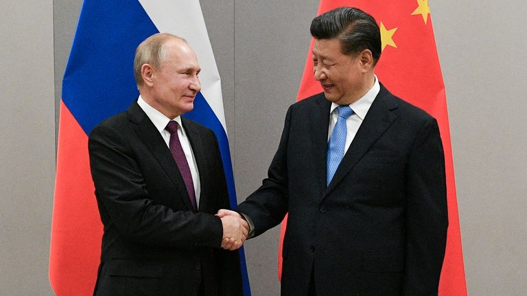 Russian President Vladimir Putin shakes hands with Chinese President Xi Jinping during their meeting on the sidelines of a BRICS summit, in Brasilia, Brazil, November 13, 2019. Sputnik/Ramil Sitdikov/Kremlin via REUTERS ATTENTION EDITORS - THIS IMAGE WAS PROVIDED BY A THIRD PARTY./File Photo