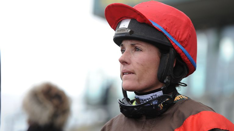 Jockey Katie Walsh is seen after riding Nouveau Moulin in the John Smiths Mares' Standard Open National Hunt Flat Race during Ladies' Day at Aintree Racecourse Liverpool, England, Friday, April 5, 2013. (AP Photo/Jon Super)