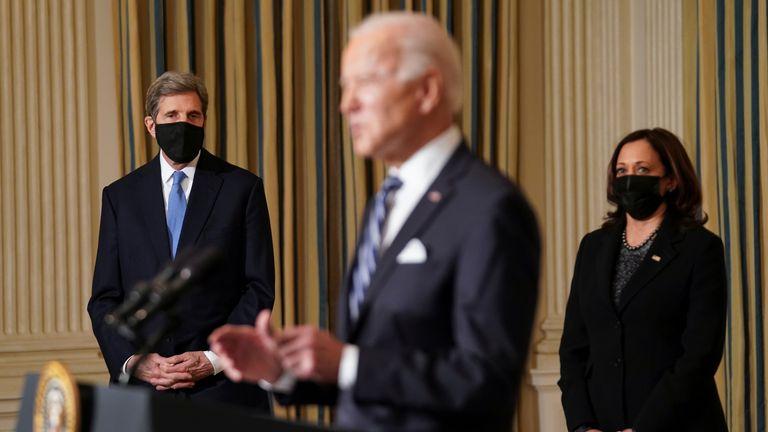 (L-R) John Kerry, US President Joe Biden and Vice President Kamala Harris