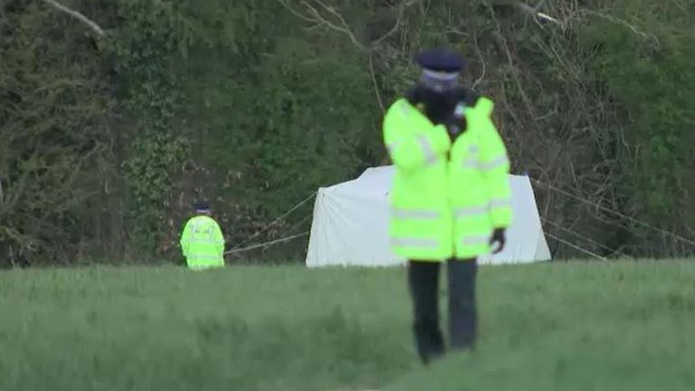 A forensics tent has been put up in a field