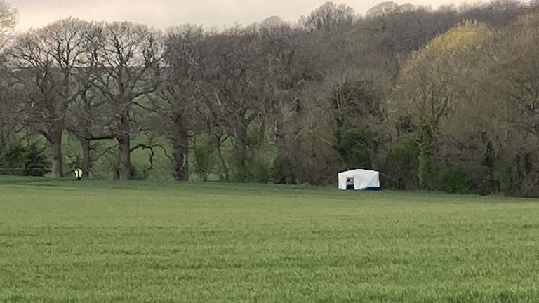 A forensic tent in Akholt Wood, near Snowdon in Kent