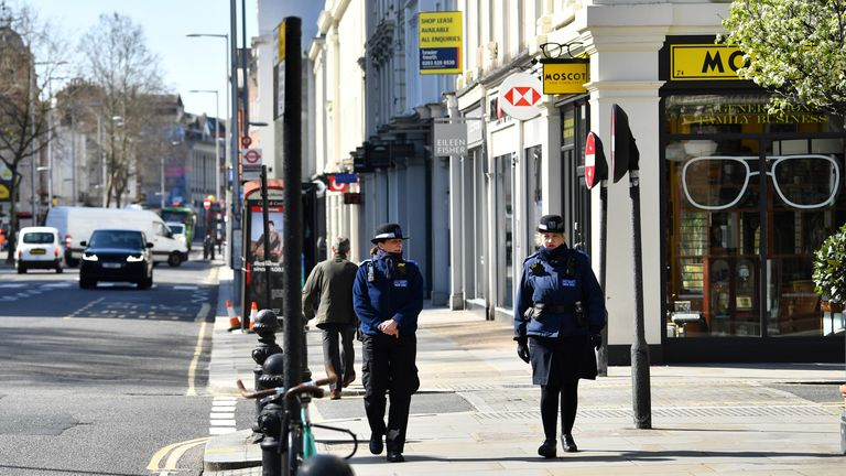 Police community support officers walk along Kings Road as the spread of coronavirus disease (COVID-19) continues in London, Britain March 24, 2020. REUTERS/Dylan Martinez